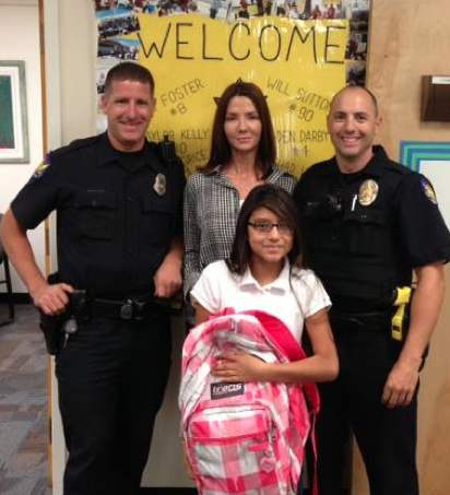 Policemen_with_school_girl_and_new_backpack