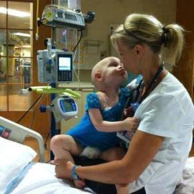 nurse kissing young cancer patient