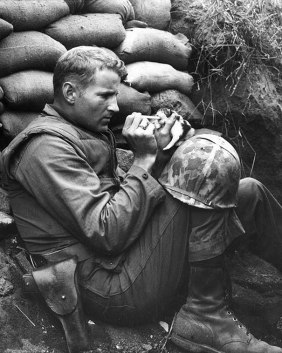solider feeding a kitten