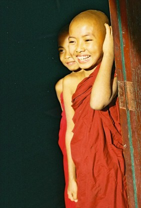 little smiling buddhist monk children