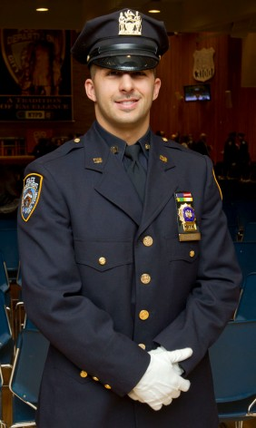 Det. Larry DePrimo poses after the promotions ceremony at Police Headquarters.