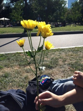 woman is given flowers in random act of kindness