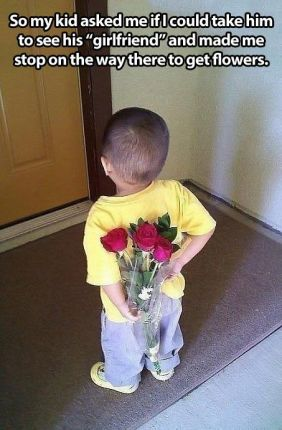 litle boy with flowers for his girlfriend - kindness