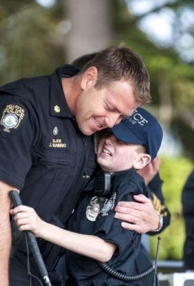 Gage Hancock hugging a policeman