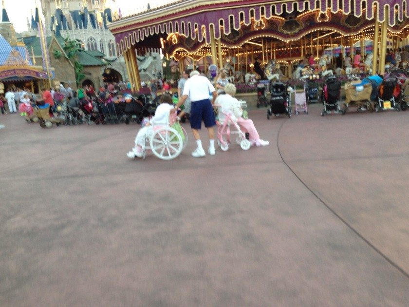 old man pushing his disabled daughter and pulling his wife at Disney world. Now that's dedication