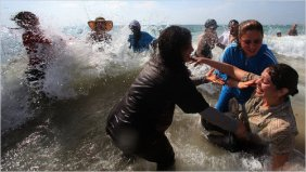 israeli and palestinian women swimming and splashing in the water - kindness