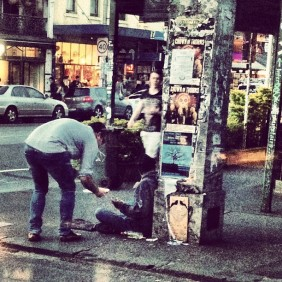 man helping a homeless person
