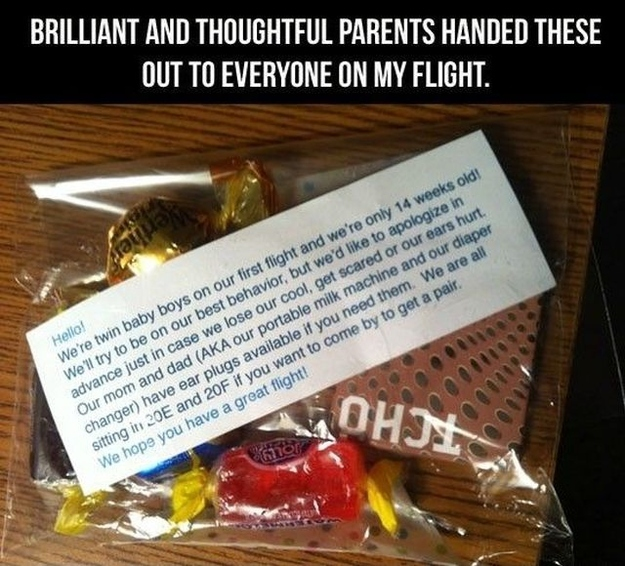 thoughtful parents of a newborn baby on a plane