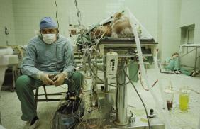 """Dr. Zbigniew Religa tracking the vital signs of a heart-transplant patient. """"I never let him out of my sight, never turned my back on him,"""" he says. """"This was the payoff."""" It was 1987, in an outmoded operating room in post-Soviet Poland."""