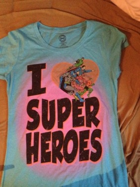 girl gives a boy a superheroes tshirt - kindness