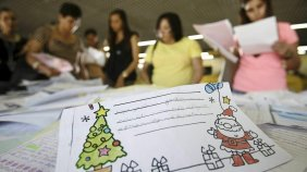 Volunteers look through children's letters to Santa at a post office in Salvador in northeastern Brazil's Bahia state. The campaign is part of a more than 20-year tradition to help those less fortunate to have gifts for the holiday.