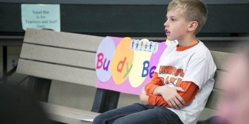 "Christian Bucks, a second-grader in York, Pa., knew that some kids on the playground didn't have many friends, so he decided to create a brightly colored ""Buddy Bench"" where kids can sit when they feel lonely or sad.  Christian first spotted the idea for a buddy bench in a brochure for a school in Germany. He thought it was a good idea and immediately talked to his principal about getting one for their school. The principal, who described Christian as a child who loves making friends and making sure others have friends, was immediately on board  ""We show we care about others when we ask others to play,"" Christian said. ""I also hope that new friendships will be made because of the buddy bench.""  (Photo via York Daily Sunday News)"