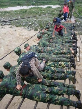 Faith in humanity restored. Chinese soldiers serving as a bridge to save people from recent floods.