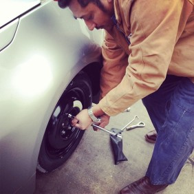 man changes a tire - random act of kindness