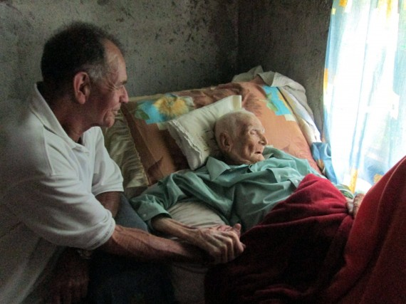 """This image was posted on imgur with this title: """"My 103 year-old great-grandfather spending his last moments with his son, my grandfather."""""""
