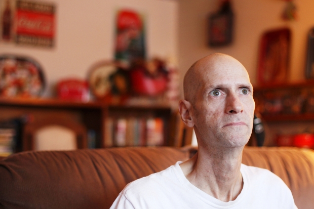 Scott Murray, suffering from non-Hodgkins lymphoma, who now says he's 'on bonus time,' as doctors had given him until this past Christmas, is running into financial issues as he tries to balance his pharmacy bills among everything else. Photograph by: Cole Burston , Ottawa Citizen