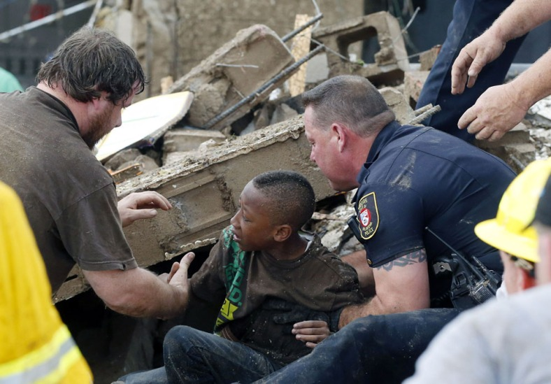 A boy is pulled from beneath a collapsed wall at the Plaza Towers Elementary School, on May 20, 2013.