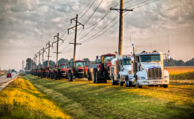 After a 31-year-old small town farmer dies of cancer, other local farmers gather in tribute, lining up their farm equipment, over 60 tractors, along the side of the road.