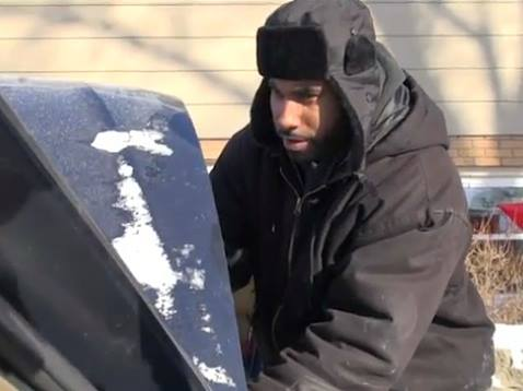 Brad McKorical kindly offers his help to help people jump start their cars - illinois