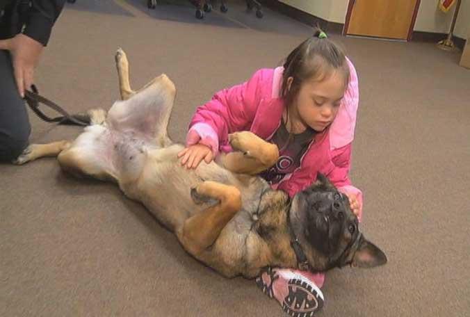West Melbourne cop, police dog change girl's life