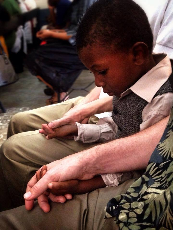 My Father is in Haiti right now. He attended a Creole service this morning when this boy sat between him and his friend without saying a word.
