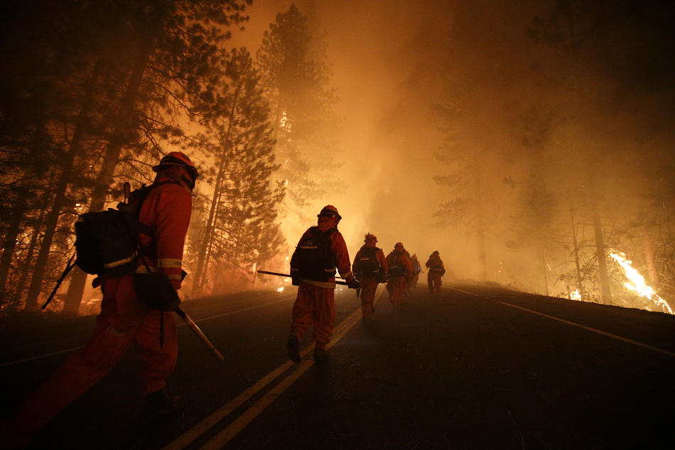 Inmate firefighters prepare to battle the Rim Fire near Yosemite National Park, Calif., in August.
