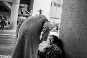 old lady giving scarf and money to homeless girl - kindness