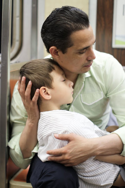 little boy sleeping in his dad's arms - humans of new york - kindness