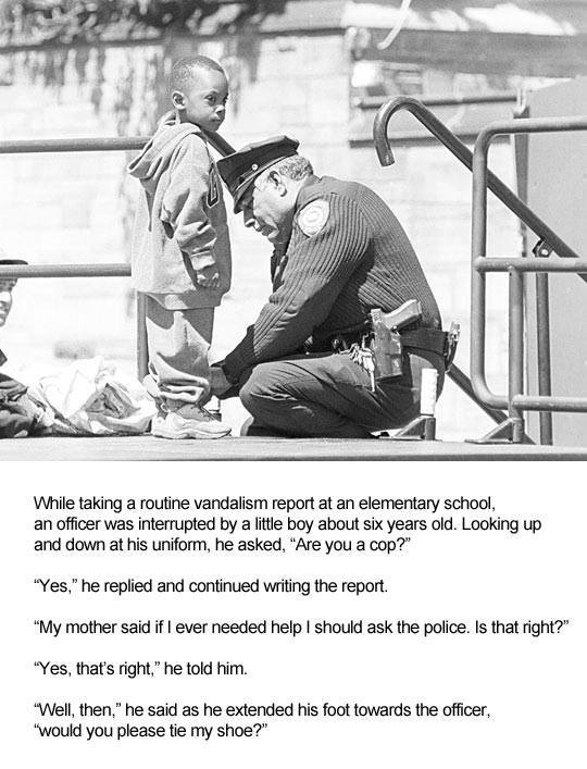 police officer ties a little boy's shoelaces