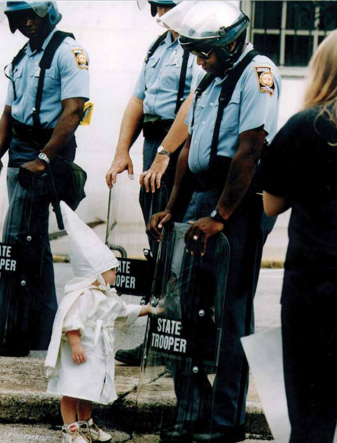 Child touches his reflection during a KKK demonstration [Georgia, USA, 1992]
