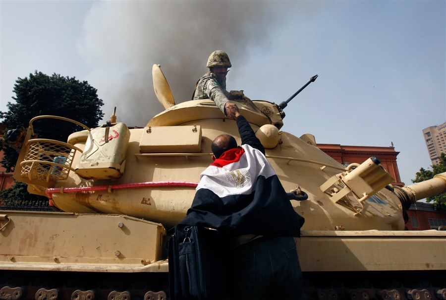 Egyptians embrace army soldiers after they refuse orders to fire on civilians [Cairo, Egypt, 2011]