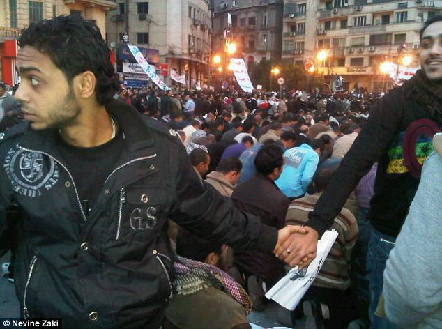 February 2011, Egypt Christians join hands to protect Muslims as they pray during Cairo protests 1