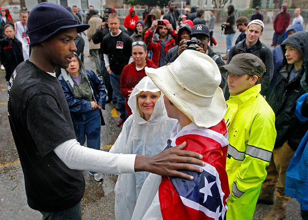 "an African American minister, Shun Abram, confronting a Klu Klux Klan protestor calmly, strongly, and with peace, are so important. There are so many ways to fight, that to have heroes like this man is so essential for all of us. What an image."" Source: Charidy.com"