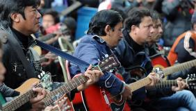 "Musicians play John Lennon's ""Imagine"" in a memorial tribute to the 23-year old Indian gang rape victim, during a mass guitar ensemble played by some 600 guitarists in Darjeeling on January 3, 2013. Protesters have massed in Indian cities daily since the December 16 assault demanding the government and police take sex crime more seriously, with tougher penalties for offenders and even chemical castration being considered. Five men accused of gang-raping a 23-year-old student on a moving bus in New Delhi in a deadly crime that repulsed the nation are to be formally charged in court January 3. AFP PHOTO/Diptendu DUTTADIPTENDU DUTTA/AFP/Getty Images"
