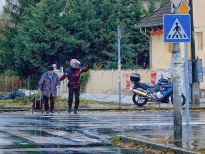 Aristavi World • 3 weeks ago He got off of his motorcycle to halt traffic, so an elderly man could cross the street.