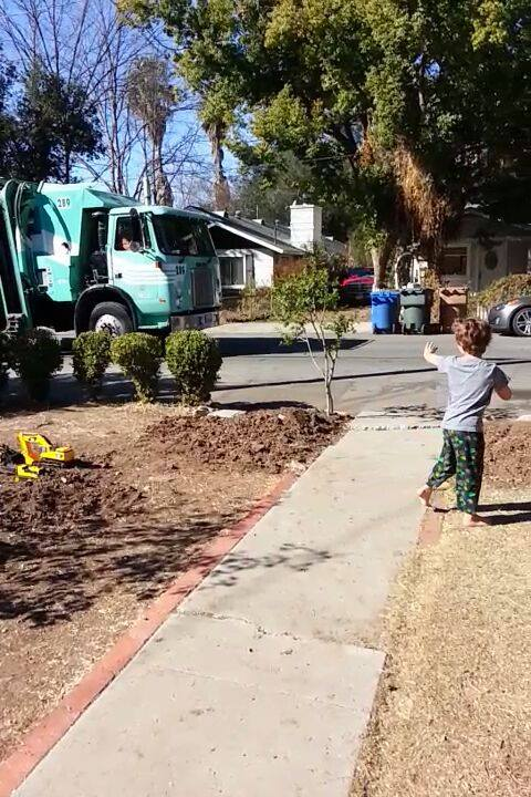 """"""" Daniel welcomes the recycling truck every Monday morning. (Robin Newberger / Facebook)"""