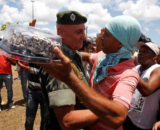 This is the aftermath of a very sweet moment between a General and a protester in Brazil.