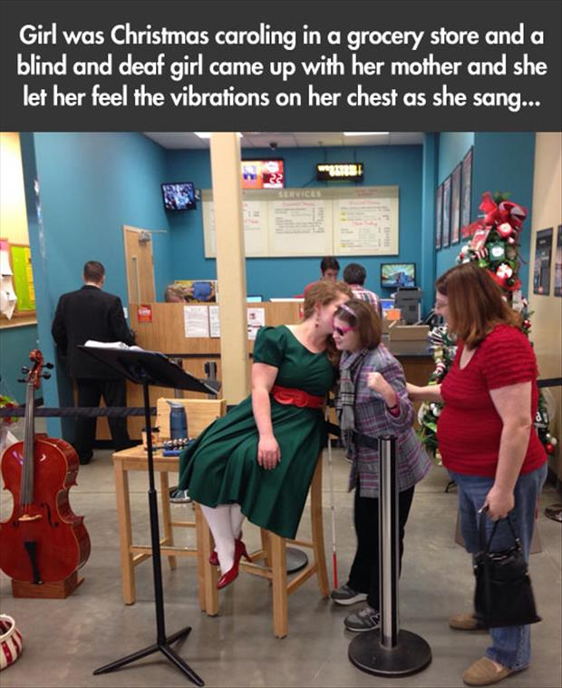 blind and deaf girl listens to vibrations of someone singing