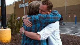 Daniel Smith receives a hug of gratitude from a stranger after giving her a Wal-Mart gift card. The gesture was part of Smith's Month of Happiness project. (Photo: courtesy Daniel Smith)