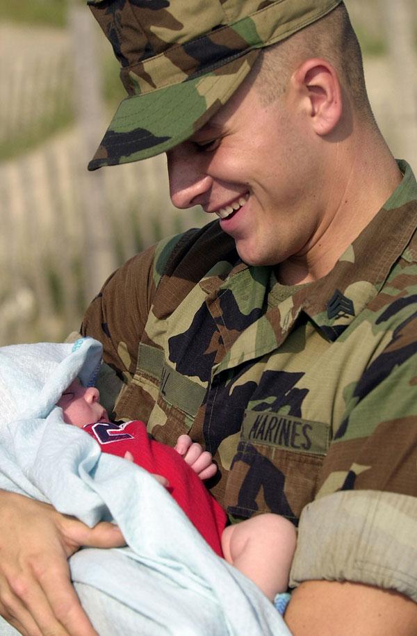 A marine meets his infant son.