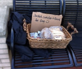free blanket left on a bench for the homeless