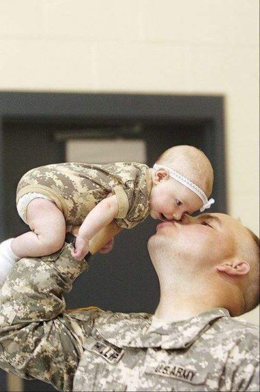 Image result for soldier holding baby