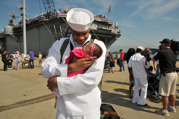 Sailor Demontay Blue meets his infant daughter.