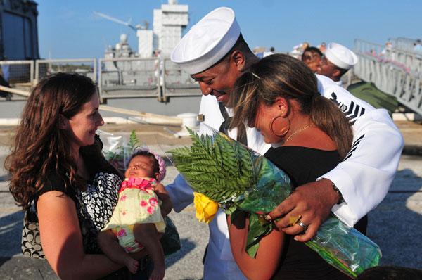 Sailor Kevin Limbrick meets his newborn daughter.