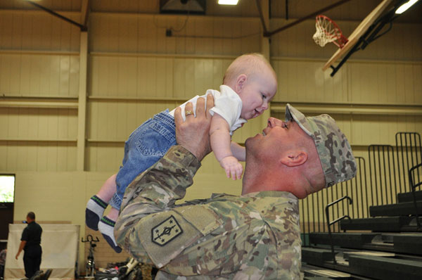 Sgt. 1st Class Michael Lewis meets his daughter.