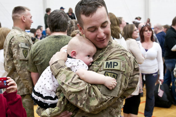 Specialist Ryan Tremble meets his 9-month-old daughter, Jade.