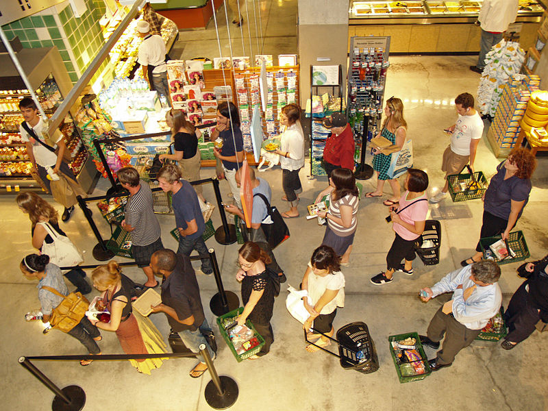 800px-Waiting_in_line_at_a_food_store