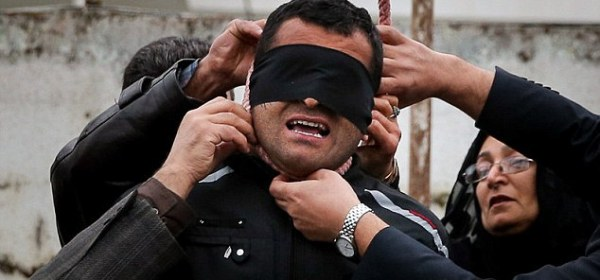 ncredible moment an Iranian killer is spared execution by his victim's mother