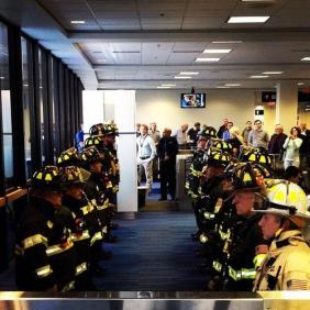 members of the Massachusetts Port Authority's Fire Department stood by at Logan Airport to meet the family of one of their fallen comrades