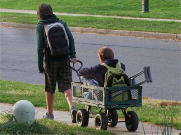 boy pulling his injured friend - kindness